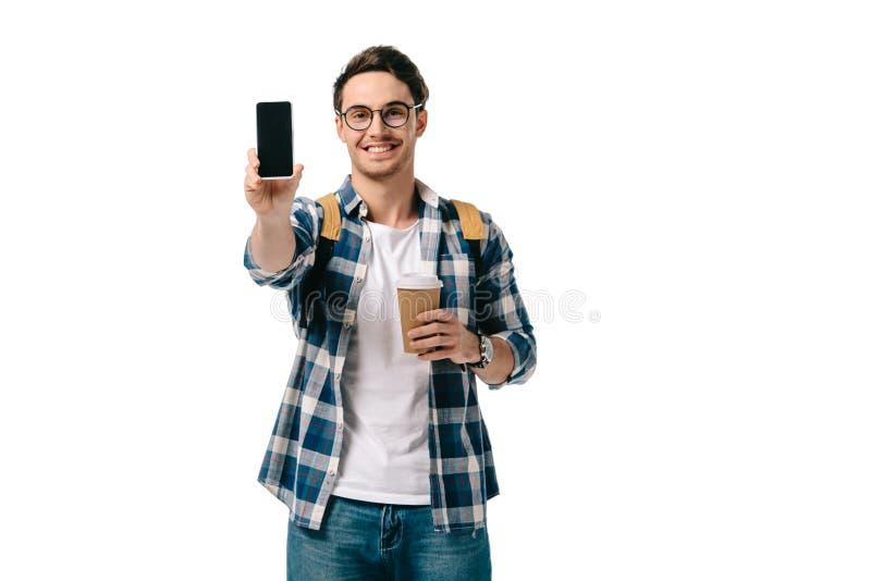 красивый студент показывая изолированный smartphone стоковые фото