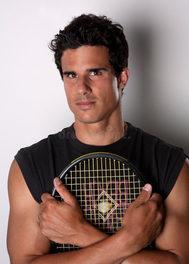 красивый теннис ракетки игрока удерживания стоковое фото rf
