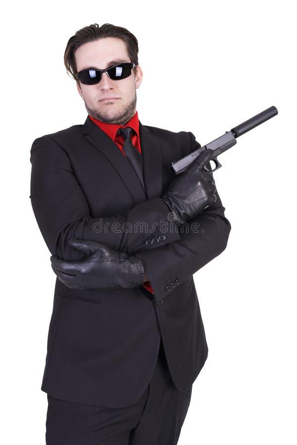 Красивый человек держа оружие стоковые изображения