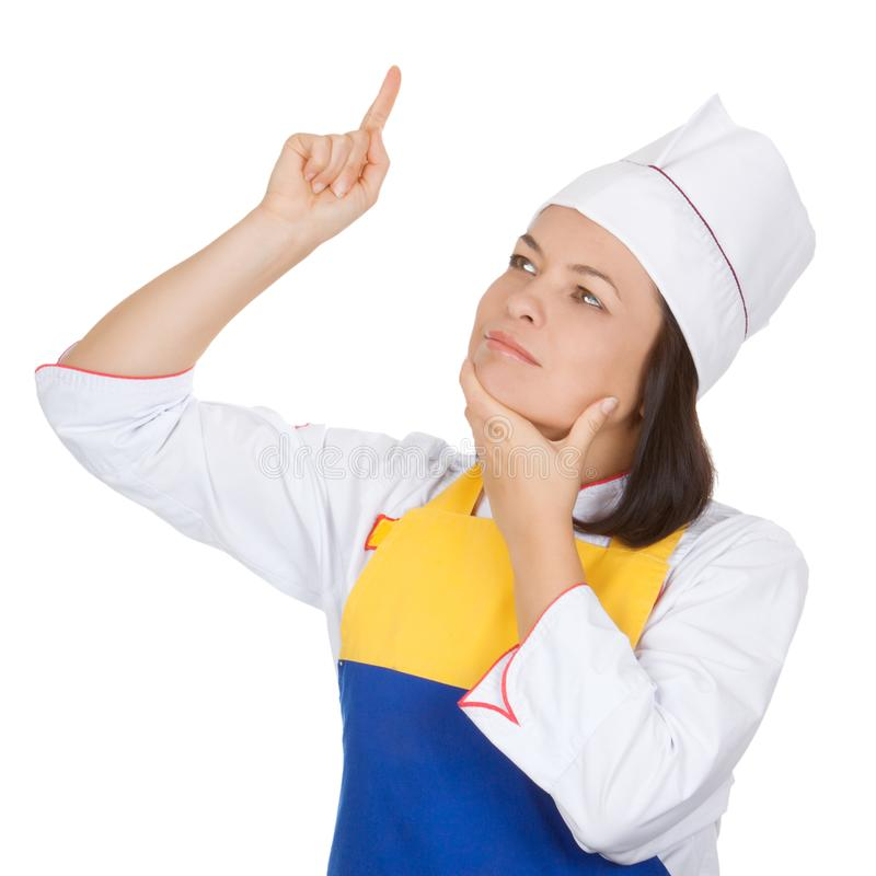Красивый шеф-повар молодой женщины думая о меню сегодня стоковое изображение rf