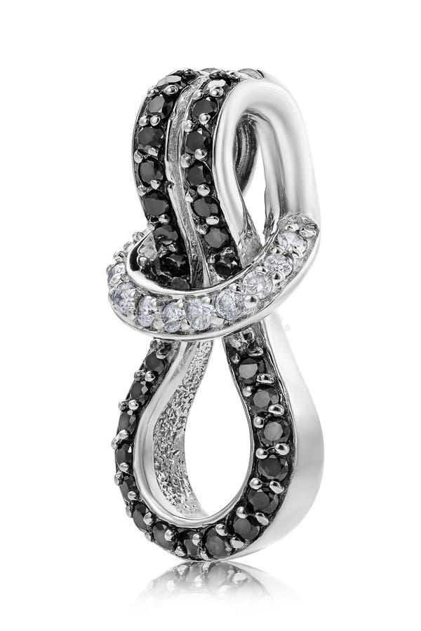 Красивый шкентель в белом золоте с кубическими zirconia и черными алмазам стоковое фото rf