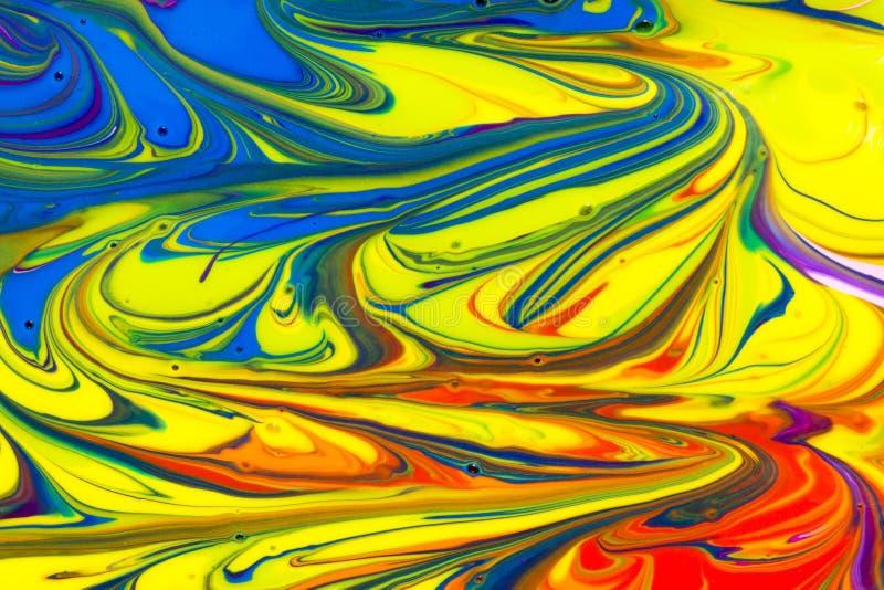 Краска конспекта пестротканая жидкостная завихряется предпосылка стоковые фото
