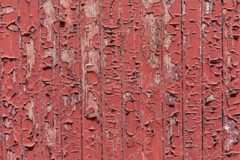 Краска на деревянной поверхности, краска с трещинами на деревянном фоне стоковое изображение