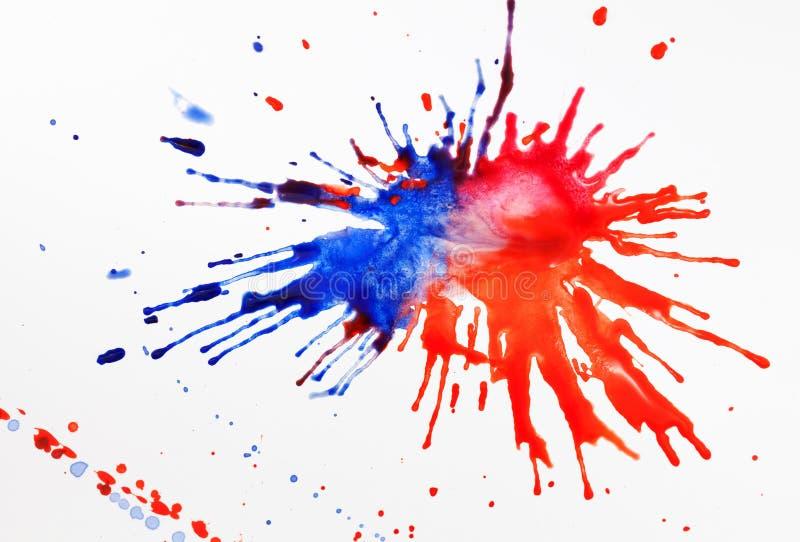 Краска на листе бумаги стоковое изображение