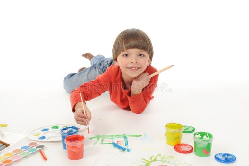 краски мальчика маленькие стоковые изображения