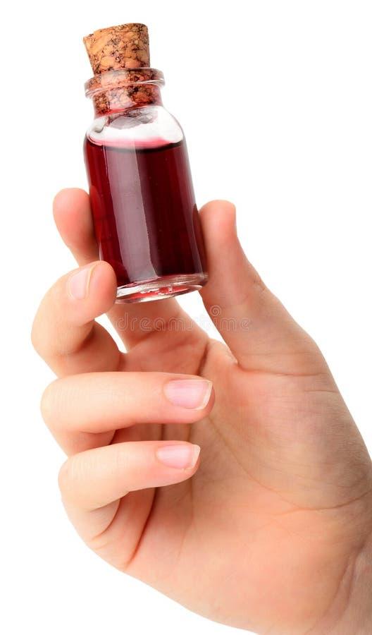 Красная бутылка зелья изолированная на белизне стоковое изображение rf