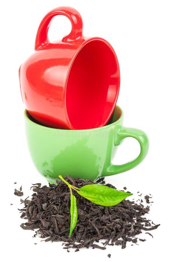 Download Красная и зеленая чашка с чаем Стоковое Фото - изображение насчитывающей черный, бело: 81812416