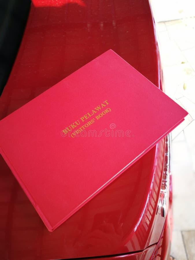 Красная книга посетителей стоковое изображение