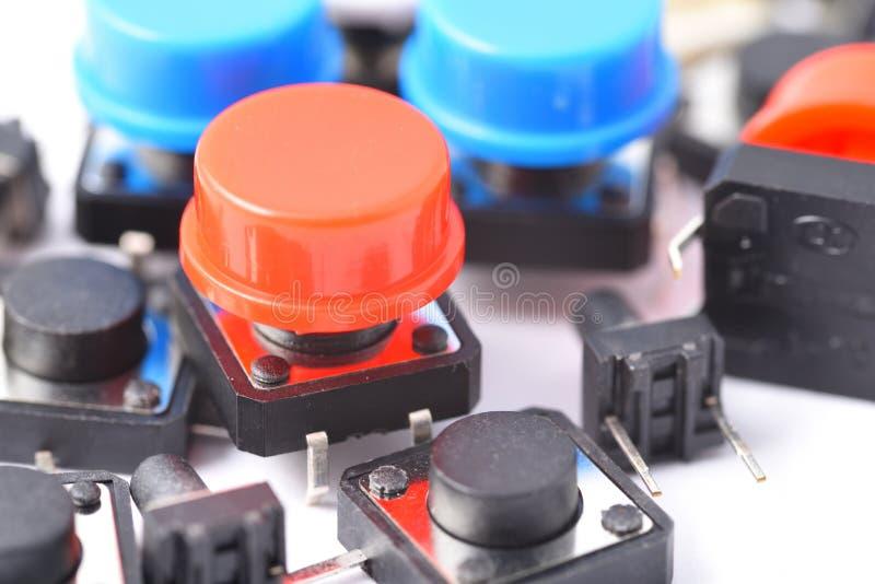 Красная кнопка, компонент к припою стоковая фотография