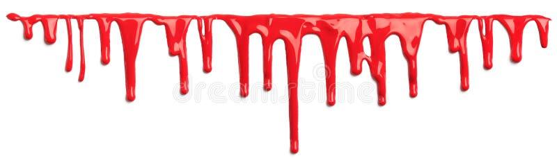 Красная кровь как изолированное капание краски стоковые фото