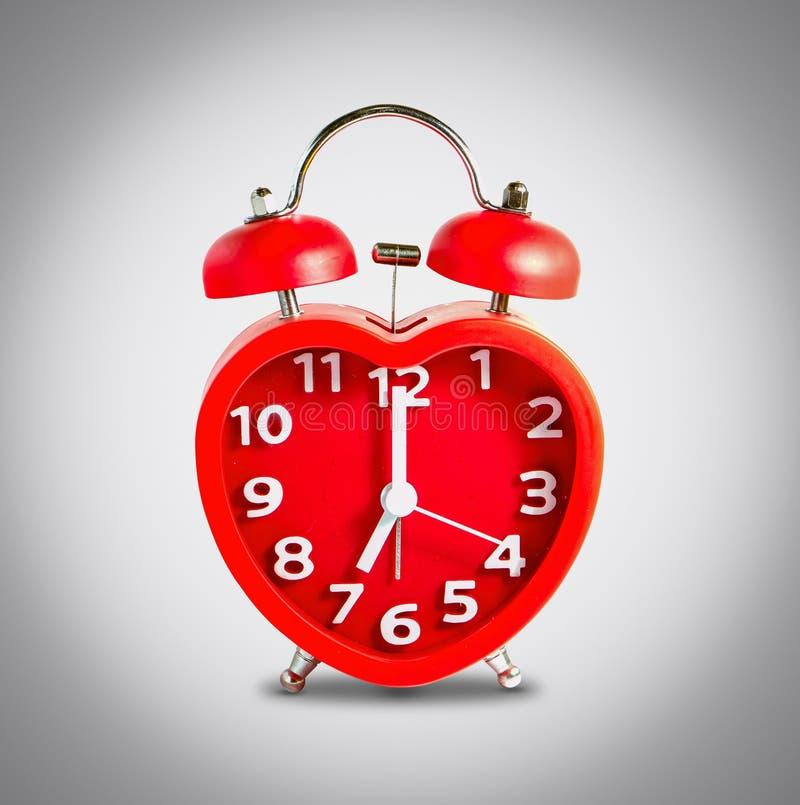 Download Красная метка звонок с двумя чашками часов на часах ` 7 O Стоковое Изображение - изображение насчитывающей красно, классицистическо: 81813489