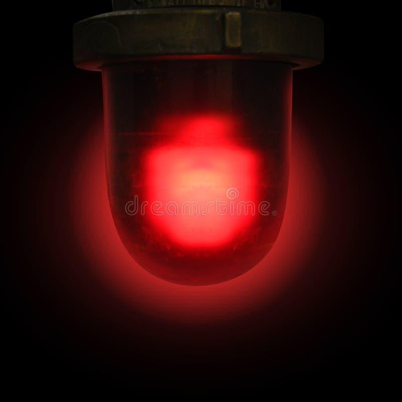 Красная непредвиденная сирена на черной предпосылке стоковая фотография