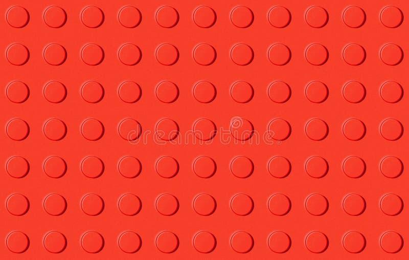 Красная пластичная предпосылка игрушки конструкции стоковая фотография rf