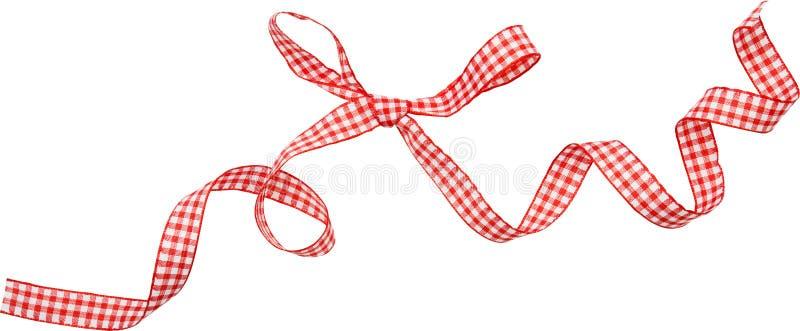 Красная скручиваемость ленты проверки изолированная на белой предпосылке стоковое изображение