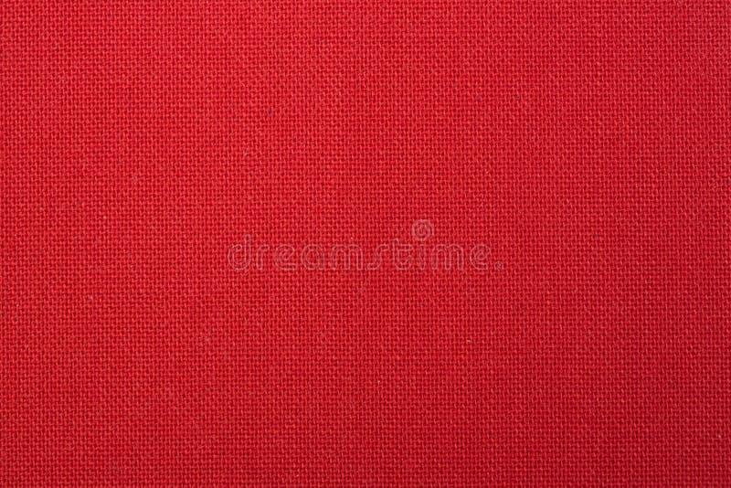 Красная сплетенная предпосылка текстуры ткани стоковая фотография rf