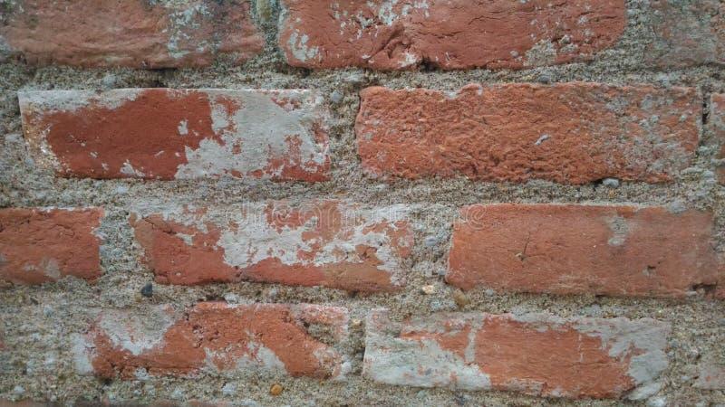Красная стена огнеупорных кирпичей стоковые фото