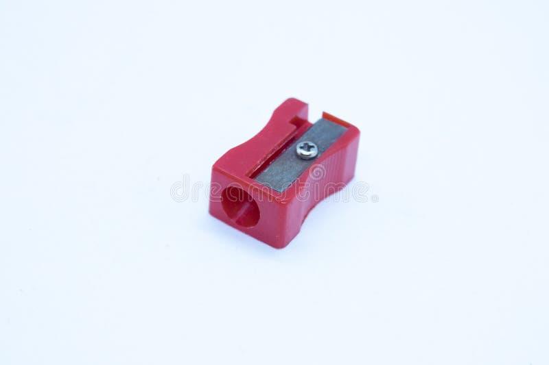 Красная точилка для карандашей изолированная на белой предпосылке стоковые фотографии rf