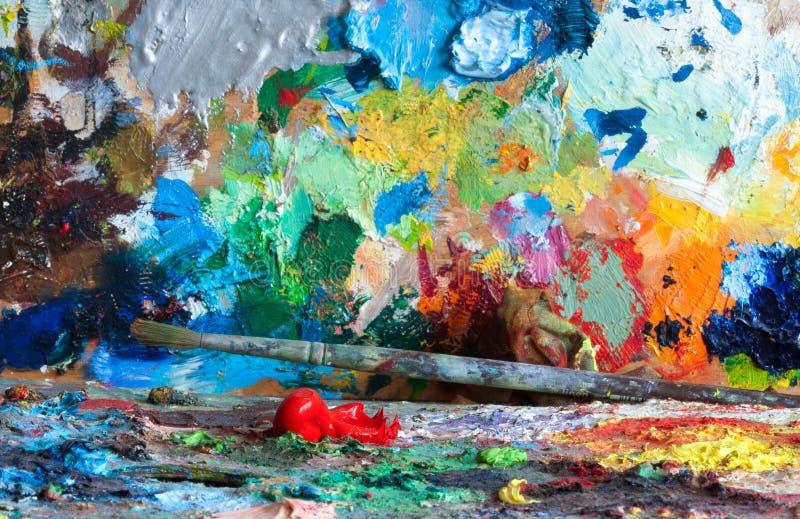 Красная фасоль на палитрах художника стоковое фото