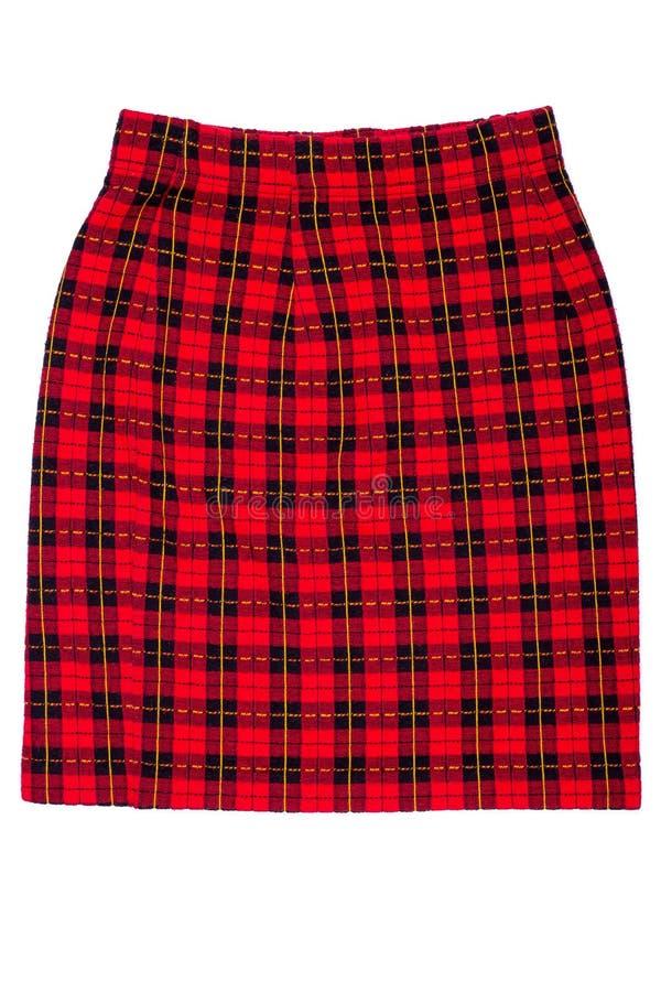 Красная checkered юбка на белой предпосылке стоковая фотография rf