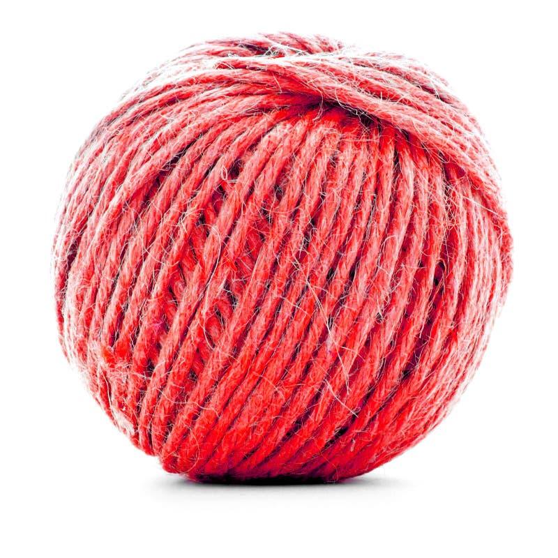 Красное пасмо шерстей, вязать крен потока изолированный на белой предпосылке стоковые фото