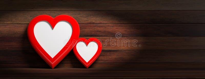 Красное сердце 2 сформировало пустые рамки на деревянной предпосылке стены, знамени стоковые изображения