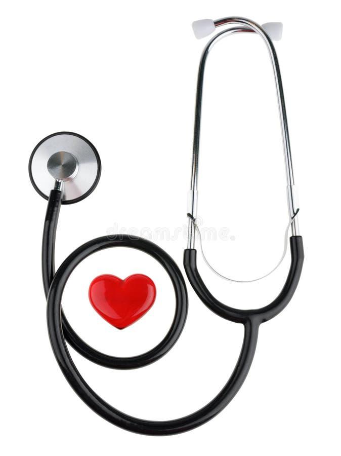 Красное сердце и стетоскоп, изолированный на белой предпосылке с путем клиппирования стоковое изображение rf