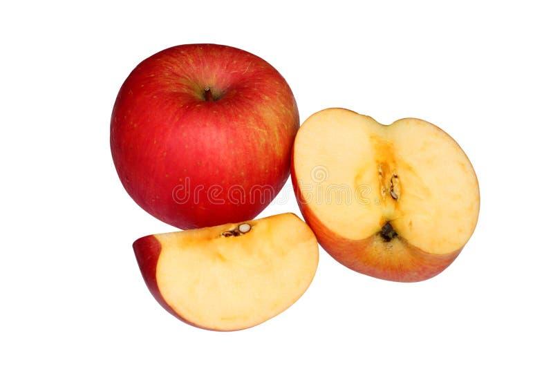 Красное яблоко и кусок изолированные на белой предпосылке стоковые фотографии rf
