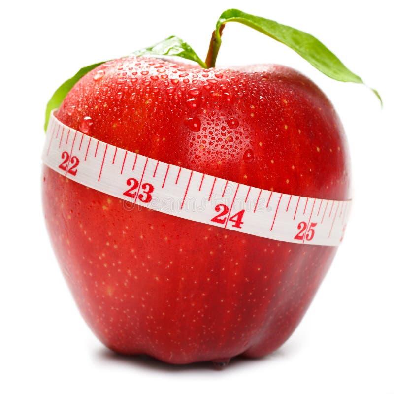 Красное яблоко с tapeline стоковая фотография rf