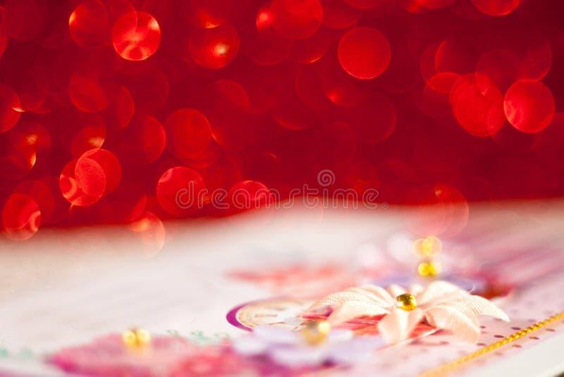 Красное bokeh на темной предпосылке стоковое фото