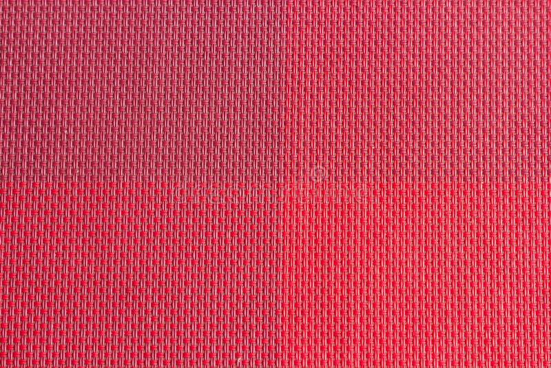 красной сплетенные пластмассой образцы ткани, предпосылка текстуры стоковые изображения