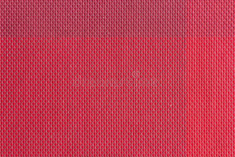 красной сплетенные пластмассой образцы ткани, предпосылка текстуры стоковые фотографии rf