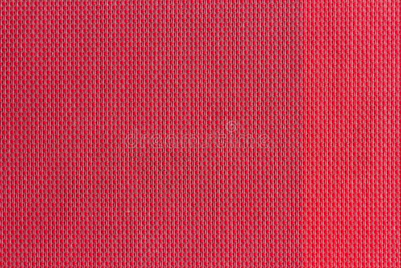 красной сплетенные пластмассой образцы ткани, предпосылка текстуры стоковые фото