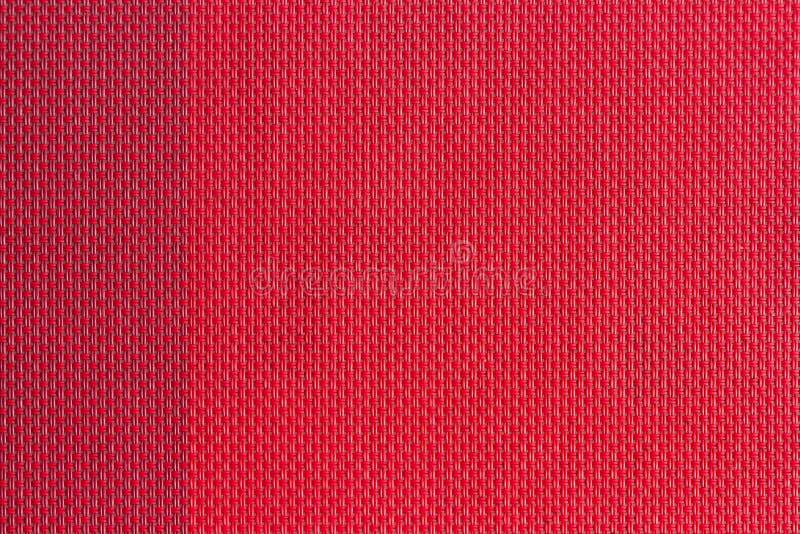 красной сплетенные пластмассой образцы ткани, предпосылка текстуры стоковое изображение