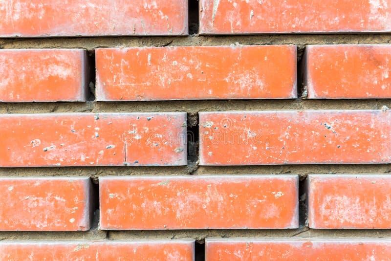 Краснокоричневой старой деревенской предпосылка текстурированная кирпичной стеной стоковое фото rf