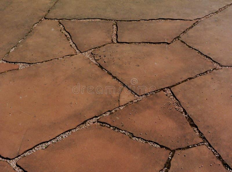 Краснокоричневый вымощать камня песка ровная плоская песочная текстура & песчинка и неровные соединения стоковая фотография rf