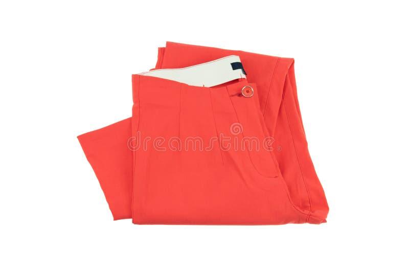 Красные брюки элегантной женщины женщина состава способа стороны принципиальной схемы красотки голубая яркая Изолировано на белиз стоковое фото rf