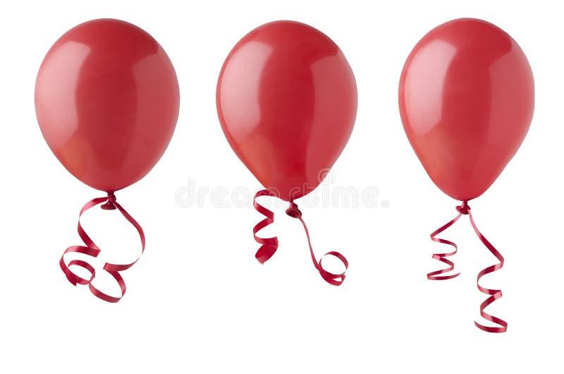 Красные воздушные шары с лентами стоковые фотографии rf