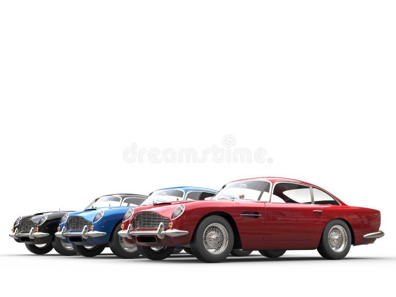 Красные, голубые и черные винтажные автомобили - съемка студии иллюстрация штока