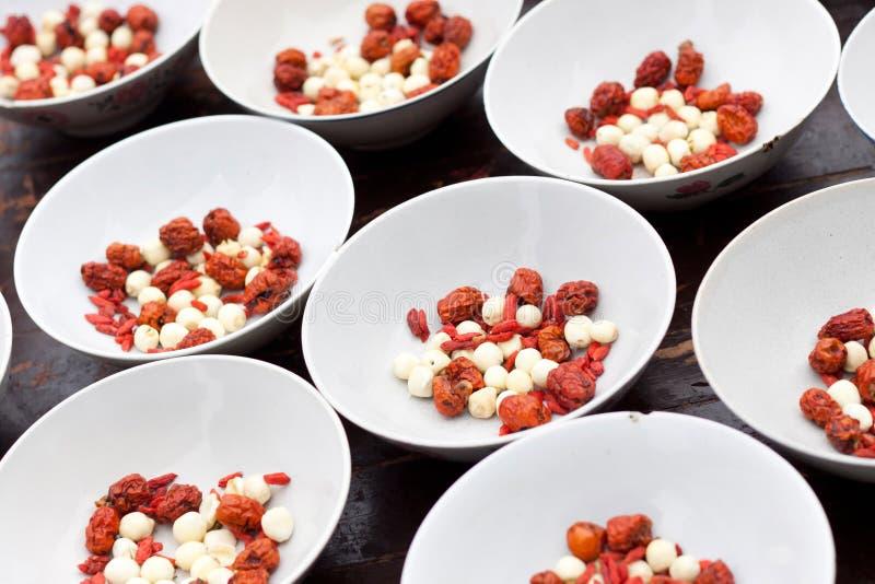 Красные даты и семена лотоса стоковое фото
