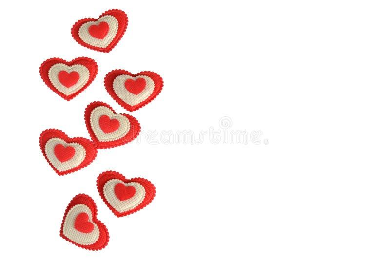 Красные и белые сердца на белой предпосылке с местом для надписи стоковые изображения