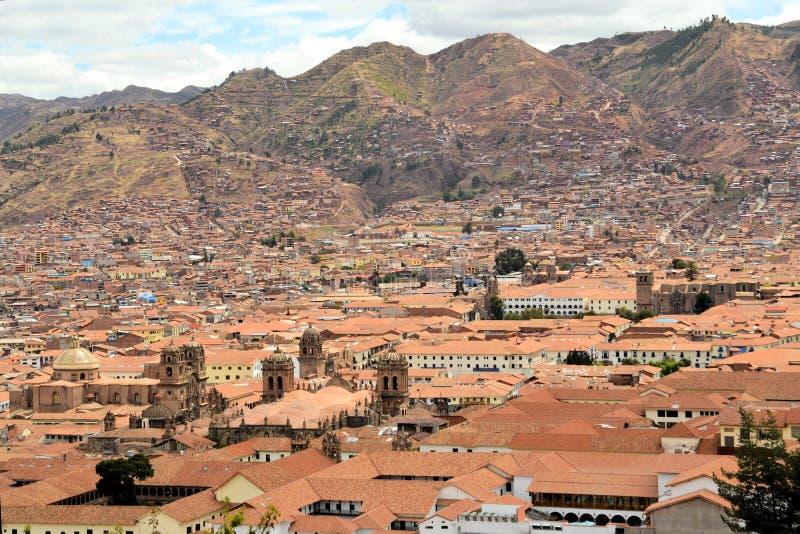 Красные крыши исторического центра, Cuzco, Перу стоковое фото rf