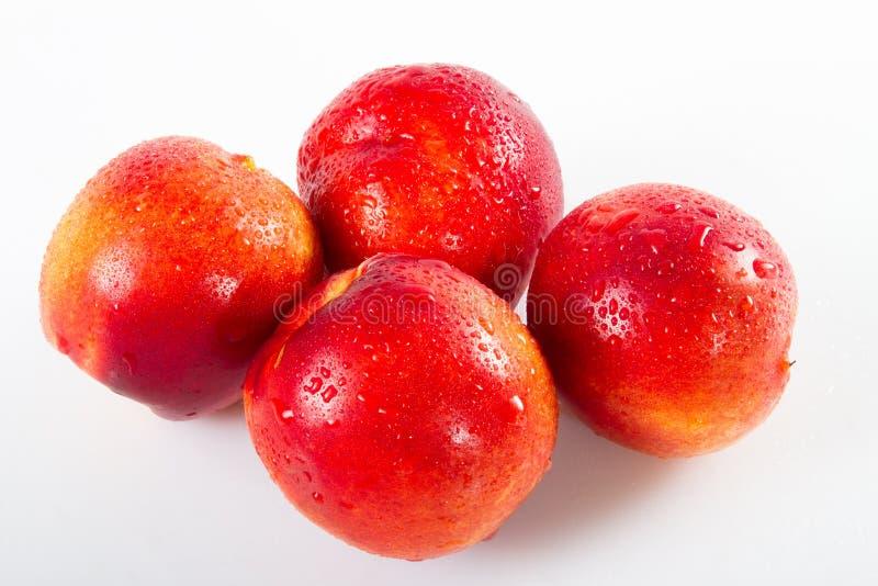 Красные нектарины супер плод, еда высокой энергии противоокислительн, нектарины ракеты -носителя здоровья сочные красные среднезе стоковые фото