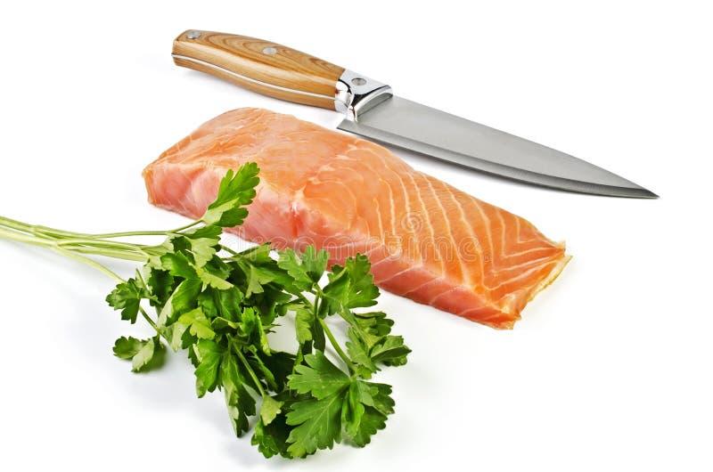 Красные рыбы над белизной стоковое изображение