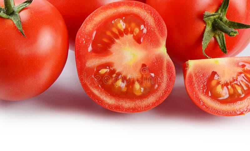 Красные свежие томаты изолированные на белизне стоковые изображения