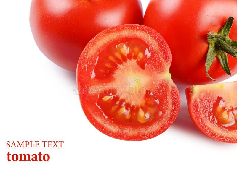 Красные свежие томаты на белизне стоковая фотография