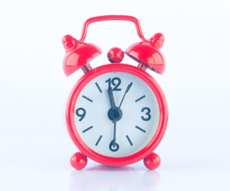 Красные часы на белой предпосылке стоковое изображение