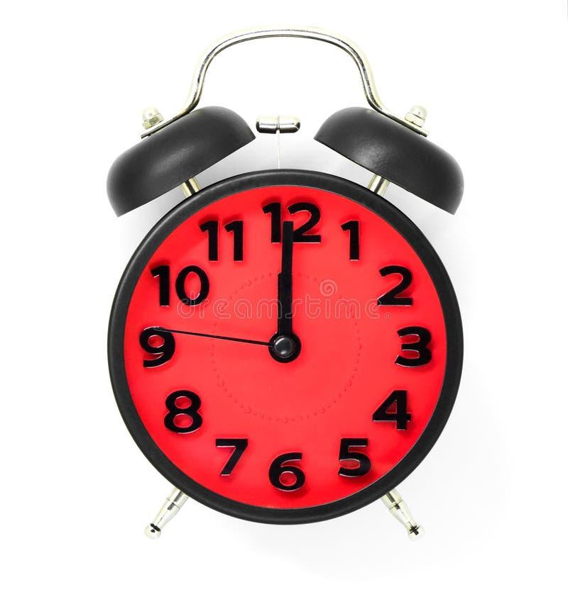 Красные часы указывая на полдень или полночь на белизне стоковые изображения