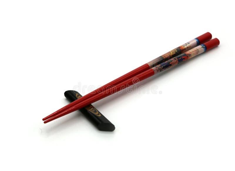 Красные японские палочки hashi стоковые изображения