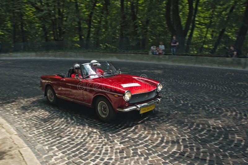 Красный автомобиль Фиат на трассе Leopolis Grand Prix стоковые фотографии rf