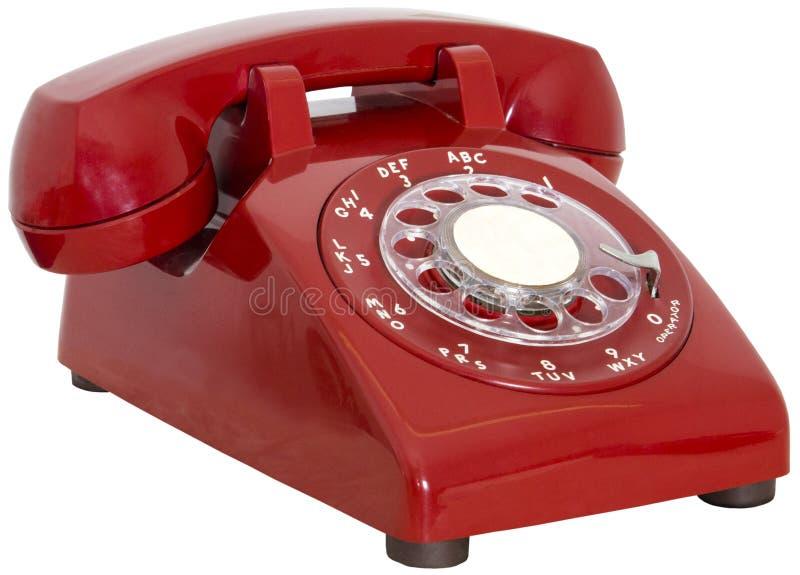 Красный винтажный роторный изолированный телефон стоковая фотография rf